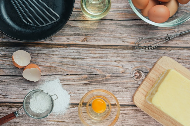 Baking ingredient: flour, egg, milk and rolling pin, top view Free Photo