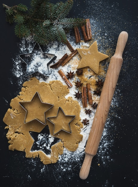 Baking ingredients for christmas holiday traditional gingerbread cookies preparation, black Premium Photo