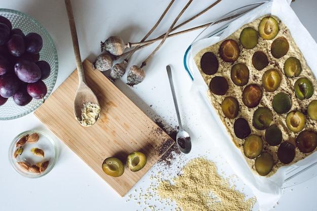 Baking a plum cake Free Photo