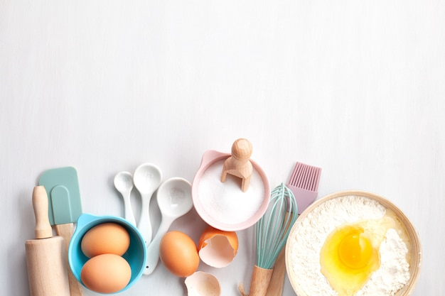 Baking utensils and cooking ingredients for tarts, cookies, pastry. Premium Photo