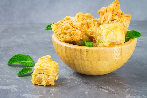 Baklava with honey and nuts Premium Photo