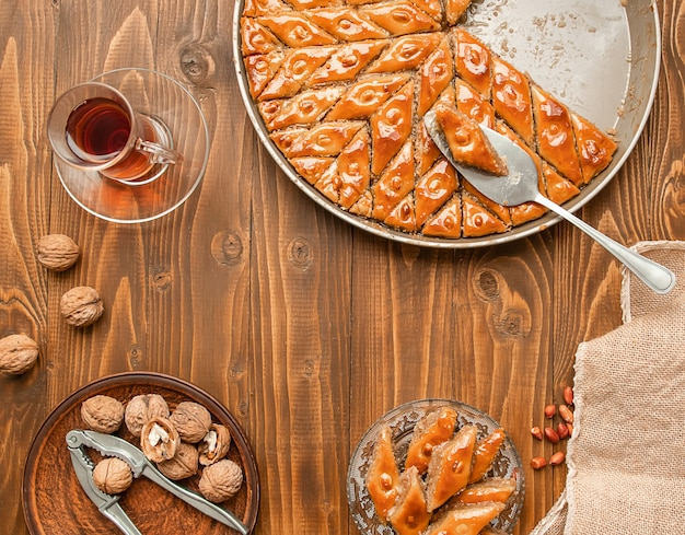 Baklava with nuts on a wooden background. selective focus. Premium Photo