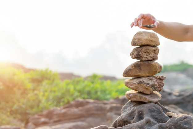 Balance and harmony stone stack, difference always outstanding and put on top Premium Photo