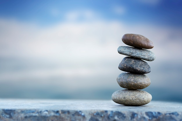 Balance stone with spa on blur sea background copy space for text Premium Photo