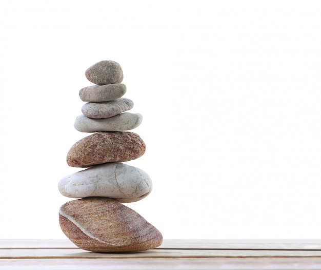 Balance stones are arranged in a pyramid shape. Premium Photo