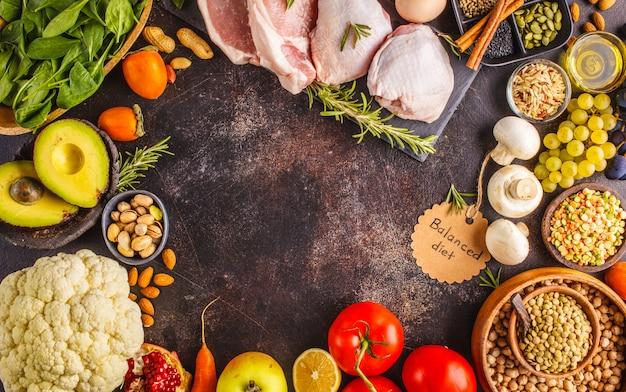 Balanced diet food background. healthy ingredients on a dark background, top view. Premium Photo