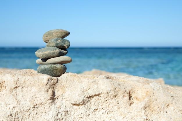 balanced stones on the sea Free Photo