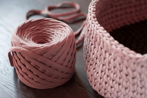 Ball of pink knitted yarn. knitting pink yarn Premium Photo