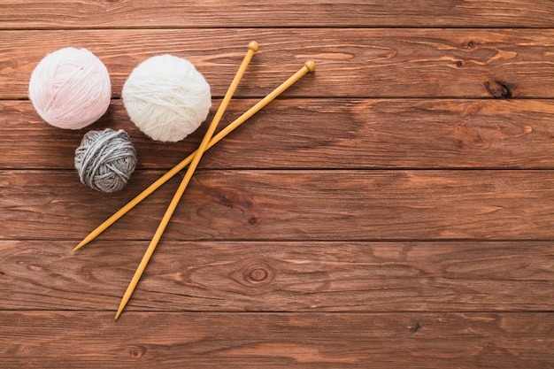 Ball of yarns and crochet on wooden plank Free Photo