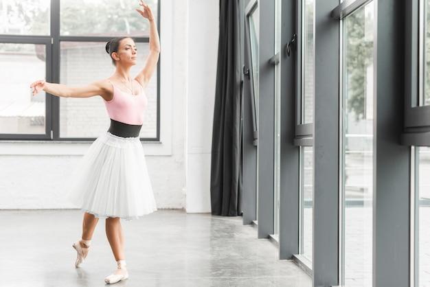 Ballerina dancing in beautiful rehearsal room Free Photo