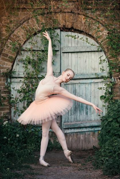 Ballerina Dancing Outdoors Classic Ballet Poses In Urban Background Premium Photo