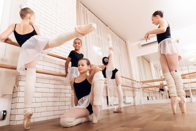 Ballet bar exercises child ballet training. Premium Photo