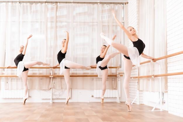 Ballet dancers rehearse in ballet class. Premium Photo