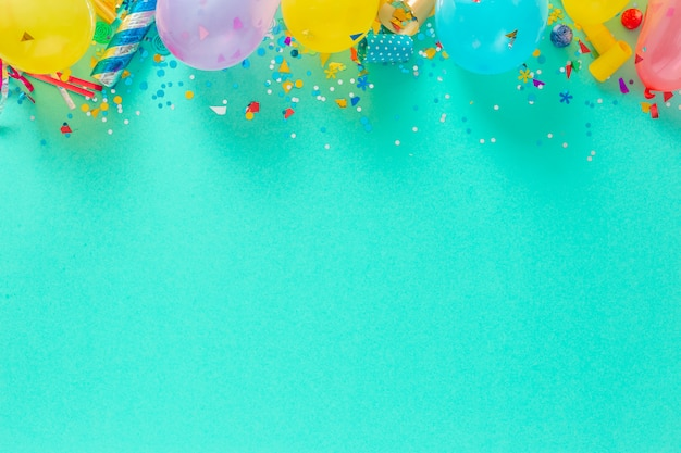 Balloons and various party decorations top view Premium Photo