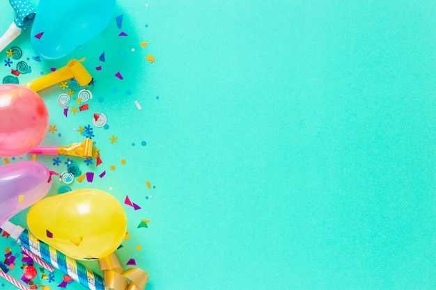 Balloons and various party decorations with copy space Premium Photo