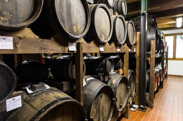 Balsamic vinegar wooden barrels storing and aging Premium Photo