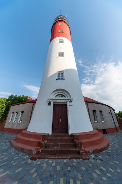 Baltic lighthouse, red white colors, bottom view. most western russian lighthouse in baltiysk city. Premium Photo
