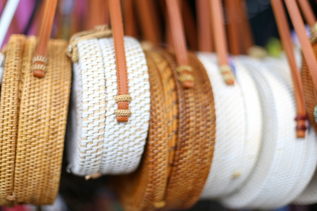 Bamboo bags in the row in local market. trendy fashion on handmade goods. Premium Photo