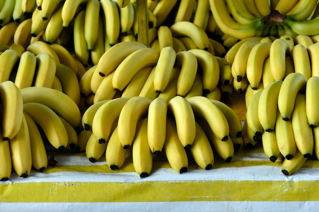 Banana bunches exposed on market stall Premium Photo