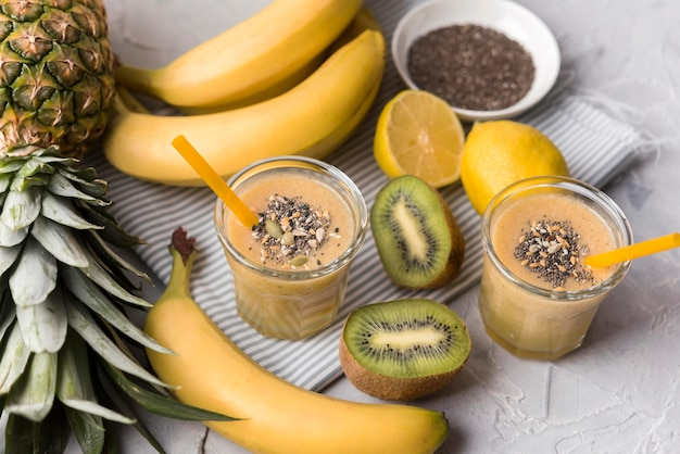 Banana and kiwi smoothies high angle Free Photo