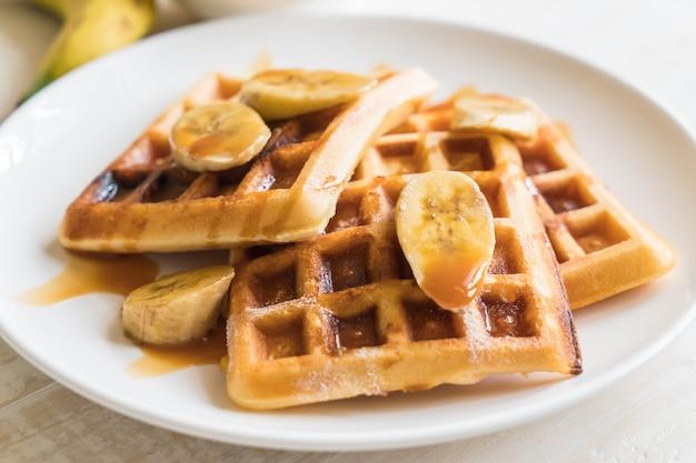 Banana waffle with caramel Premium Photo