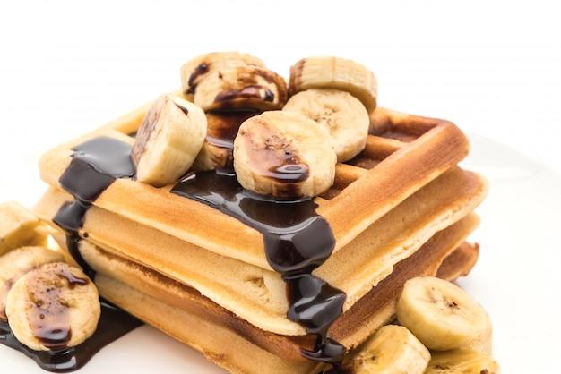 Banana waffle with chocolate Premium Photo