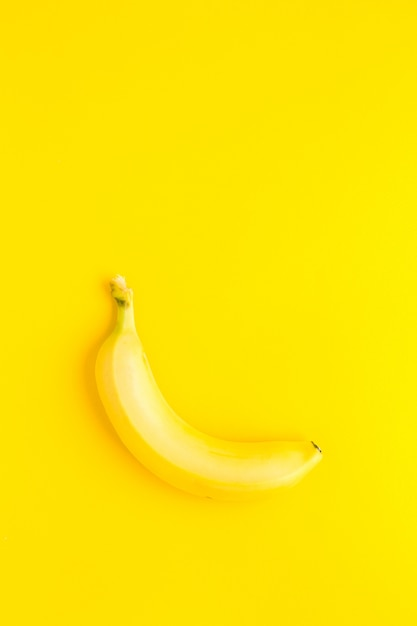 Banana on the yellow background. banana top veiw Premium Photo