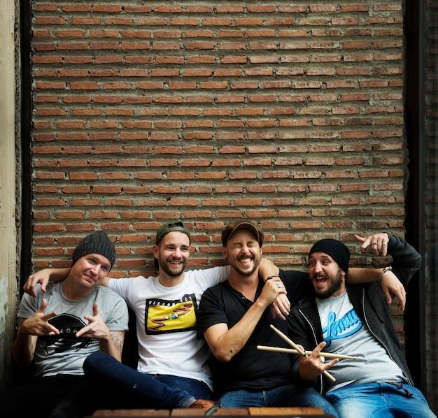 Bandmates having fun and laughing together Premium Photo