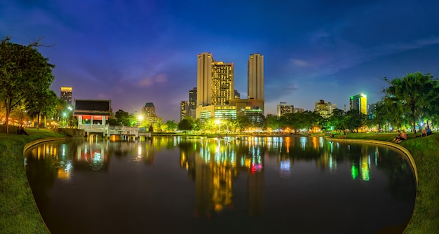 Bangkok business district with the public park area in the foreground at sunset time Premium Photo