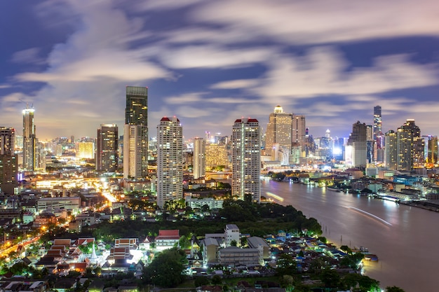 Bangkok city skyline aerial view at night time and skyscrapers of midtown Premium Photo