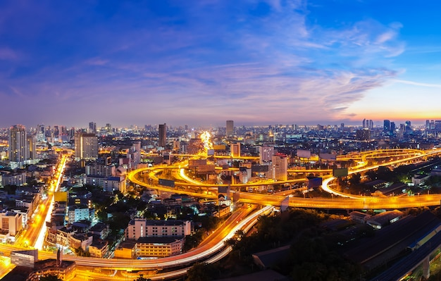 Bangkok city with light trail on express road at sunset. beautiful cityscape at dusk. Premium Photo