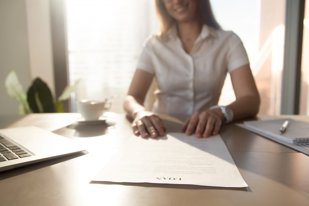 Bank worker offering loan agreement, focus on document, close up Free Photo
