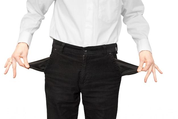 Обанкротившийся мужчина показывает пустые карманы Premium Фотографии