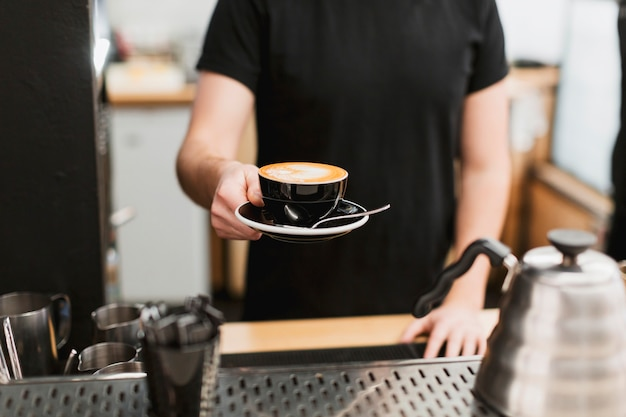 Bar concept with man holding coffee Free Photo