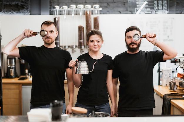 Bar concept with three barmen Free Photo