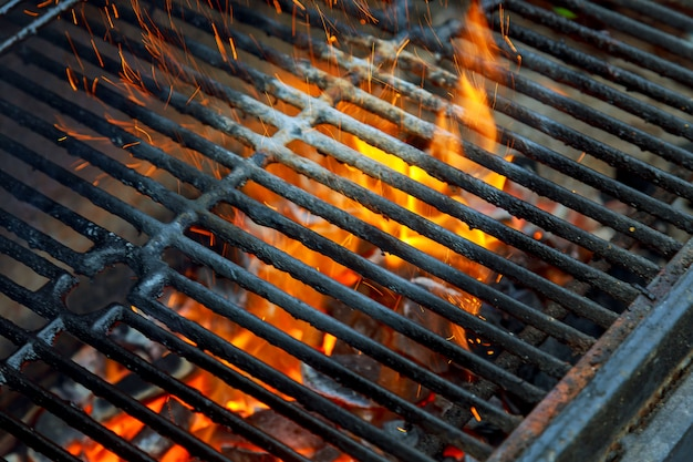 Barbecue grill, hot coal and burning flames. you can see more bbq, grilled food, Premium Photo