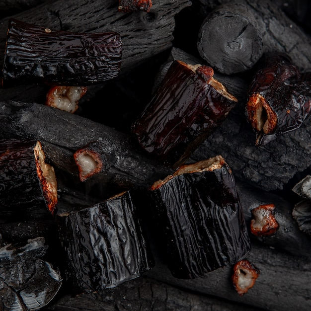 Barbecued egg-plants on charcoal. Free Photo