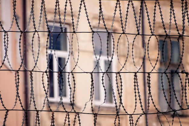 Barbed wire and windows of a building Premium Photo