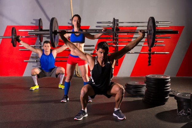 Barbell weight lifting group workout exercise gym Premium Photo