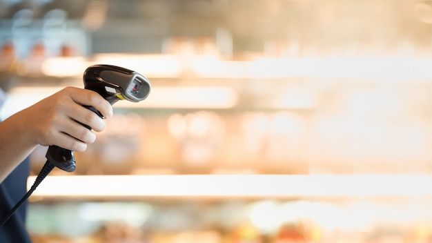 Barcode scanner in hand Premium Photo