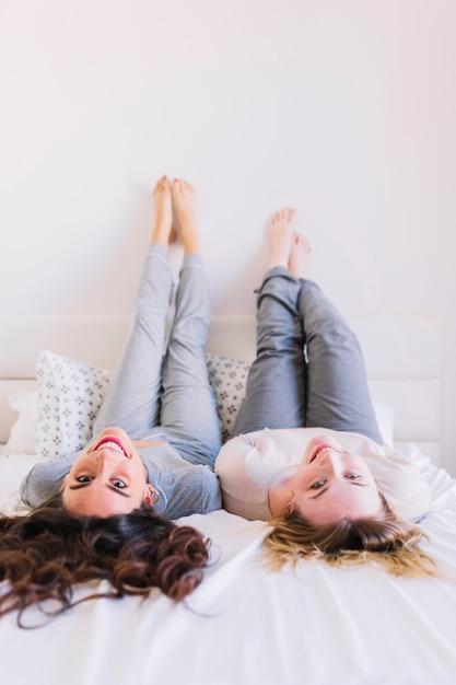 Barefoot women lying on bed photo free download barefoot women lying on bed free photo malvernweather Choice Image