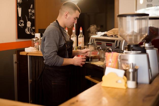 Barista making cappuccino, bartender preparing coffee drink Premium Photo