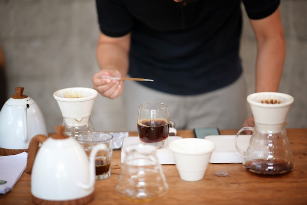 Barista making drip coffee and accessories on the table Premium Photo