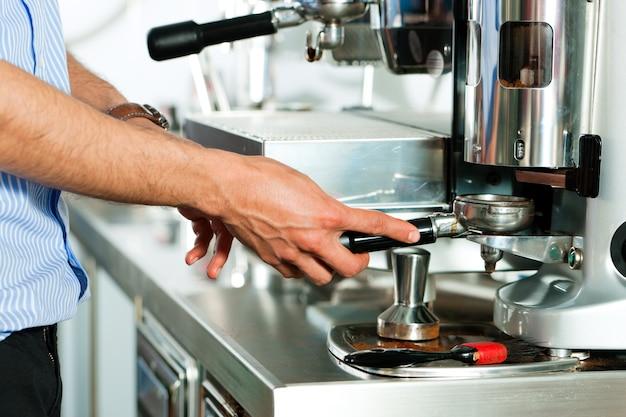 Barista prepares espresso Premium Photo