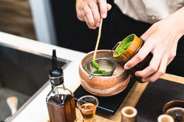 Barista preparing green tea drink Premium Photo
