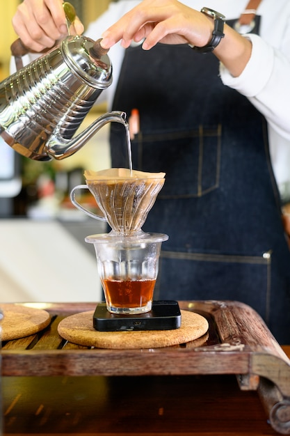 Barista woman girl hot water prepare filtered coffee Premium Photo