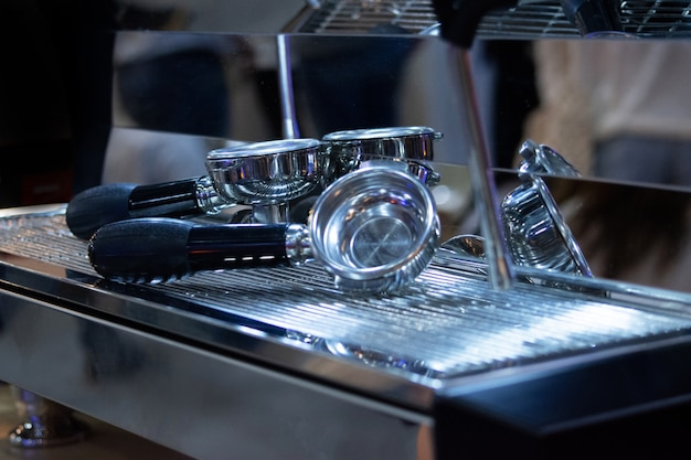 Barista working in a coffee shop, close up of barista presses ground coffee using tamper Premium Photo