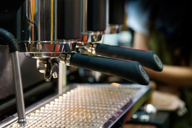 Barista working in a coffee shop Premium Photo