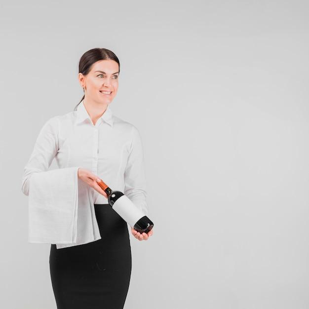 Barkeeper holding bottle of wine Free Photo