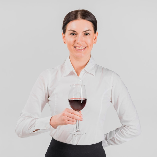 Barkeeper smiling and holding glass of wine Free Photo